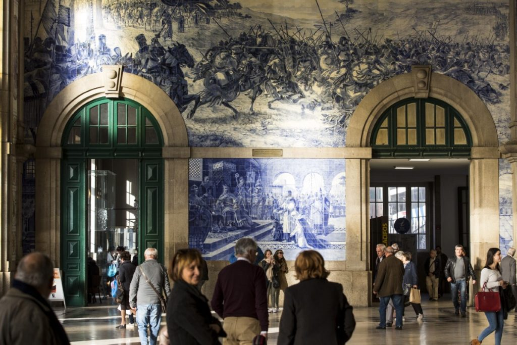 Porto São Bento station where the tiles depict scenes of royal gatherings and traditional rural life.