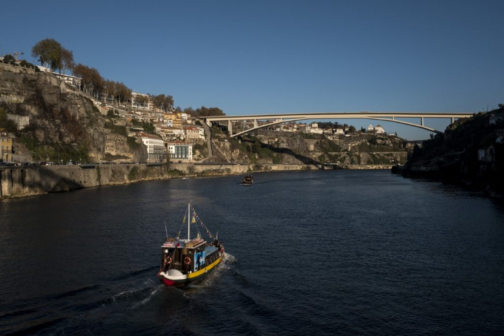Rabelo boat Porto dramatically perched at the mouth of the Rio Douro